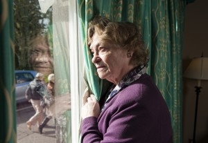 older woman at window